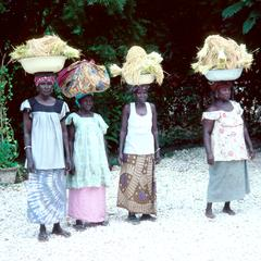 Women with Pans of Paddy Rice on Heads