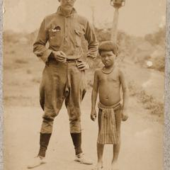 American soldier with Filipino child