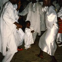 People dancing with a child