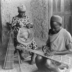 Woman Making Fish Net and Man Making Fish Trap