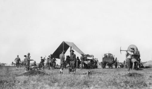 Soldiers of the US Army's 15th Infantry Regiment setting up tents.