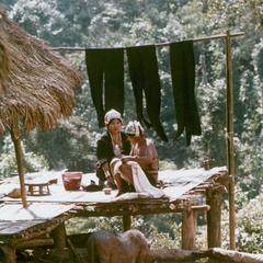 Akha women drying the indigo colored cloth in the village of Phate in Houa Khong Province
