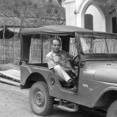 Man in jeep visiting aid mission, outside of residence-office of JMH