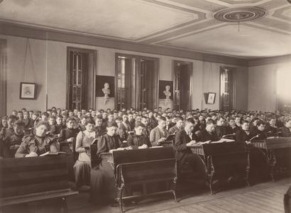 River Falls Normal School assembly room with students