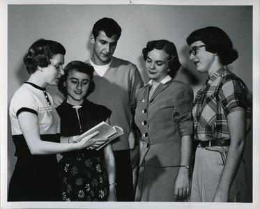 """Alpha Psi Omega members studying a script for Stout Institute's Fall play """"Petticoat Fever"""""""
