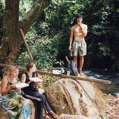 Group rest under tree in Kintampo Falls