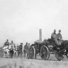 Soldiers of the US Army's 15th Infantry Regiment marching with horse-drawn carts.