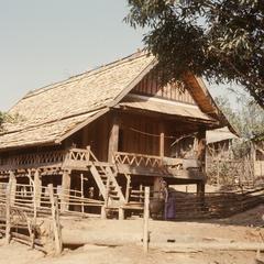 Khmu' woman dehusking rice