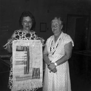 Helen Louise Allen with another woman and a weaving