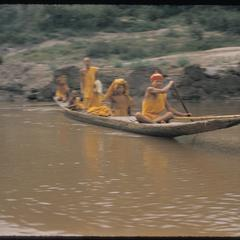 Young bonzes paddling pirogues on the Mekong near Luang Prabang town