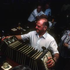 Art Altenburg plays concertina at his bar