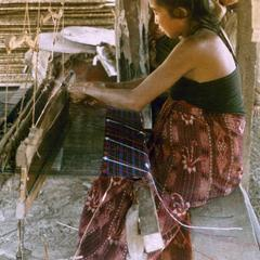 A Kalom woman weaves a new skirt in Houa Khong Province