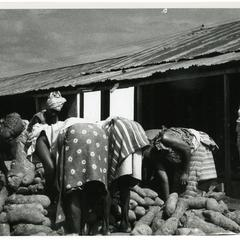 Mrs. Ogendengbe and co-sellers selling yams at the market