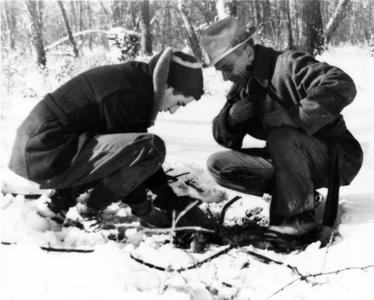 Aldo Leopold and Carl Leopold lighting a fire