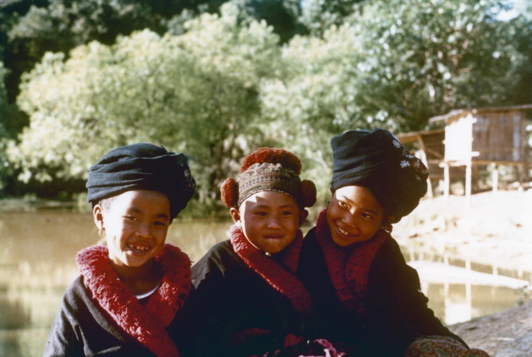 Three Yao Iu Mien Girls Are Seated Near A Pond At In Houa Khong Province Uwdc Uw Madison Libraries