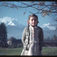 Bavarian child with snow-covered mountains in the background