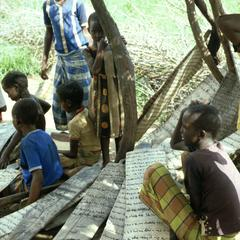 Students in Koranic School Writing with Charcoal