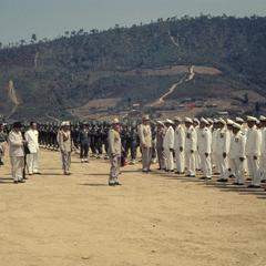 The King of Laos inspects soldiers and officials with dignitaries