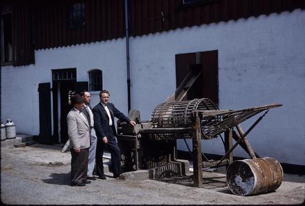 Men with farm equipment