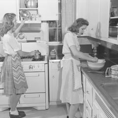 Students in the home management house kitchen