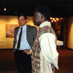 Agbo Folarin and Dick Ammann looking at art at reception