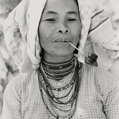 A Nyaheun woman smokes a tobacco pipe in Attapu Province