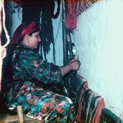 Woman Weaving Rug for Commercial Dealer