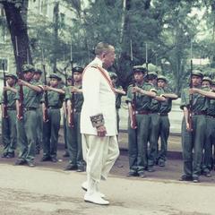 King Savang Vatthana inspects the Pathet Lao honor guard