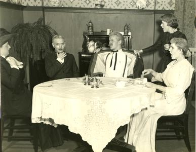 Alpha Psi Omega - Performing a play onstage, dining room scene