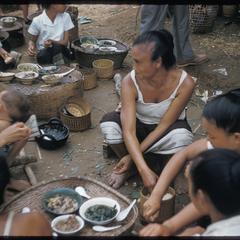 Lao women eating