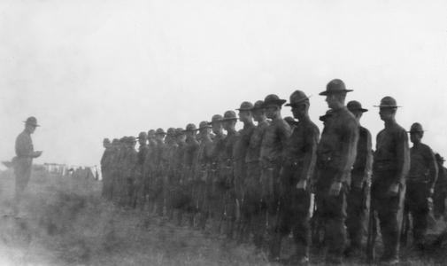 Soldiers of the US Army's 15th Infantry Regiment standing in formation with an officer in front of them.