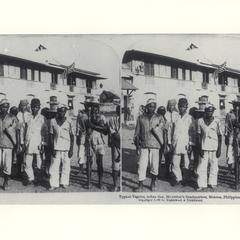 A group of Tagalog men in front of General MacArthur's headquarters, Malolos, 1899