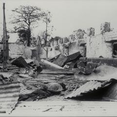Dead Filipino amid ruins, 1945