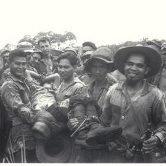Filipino civilians bring in a Japanese prisoner, Mindanao, 1945