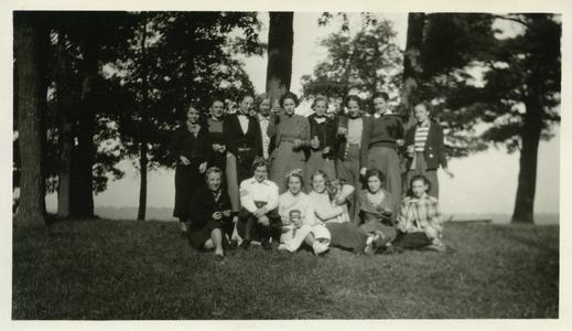 Women's Athletic Association group photograph with dog