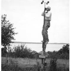 E. A. Birge reading an anemometer
