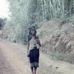 A Nyaheun woman walks on the road from her highland fields in Attapu Province