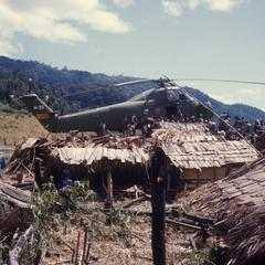 Helicopter transporting harvested rice