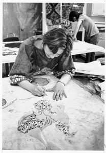 Student working on a batik wall-hanging