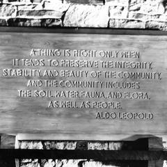Plaque with Leopold quote above fireplace at Forest Preserve District of Cook County, Illinois