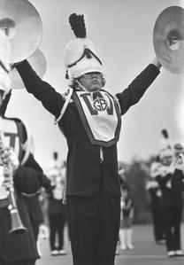 Marching band member with cymbals