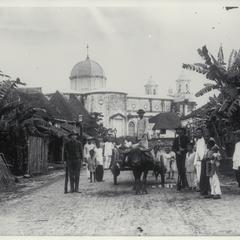 Manila street scene showing church in the background, 1899-1901