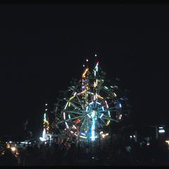 That Luang fair : Ferris wheels at night