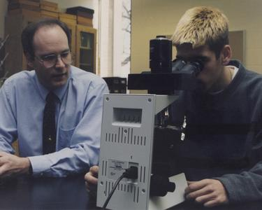 Tom Klubertanz with a student