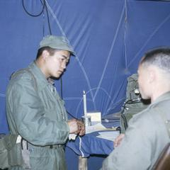 Hmong official with soldier