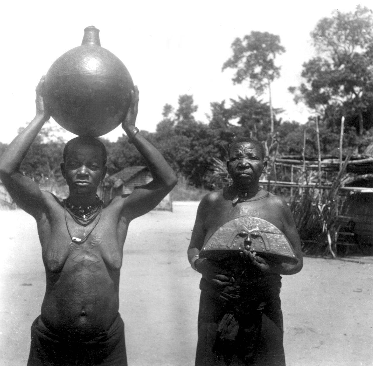 Two Women Displaying Goods