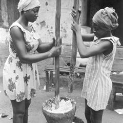 Women Pounding Grated Coconut