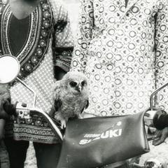 Boy with owl at Oshu market