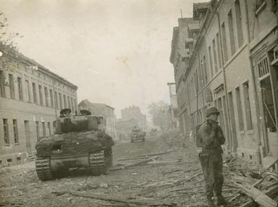 Tank rolls down the trashed streets of Magdeburg