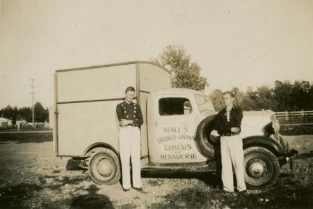 Circus performers standing by truck